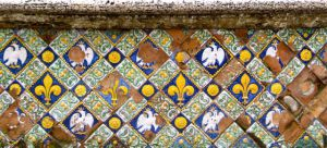 Renaissance tile on a garden wall.