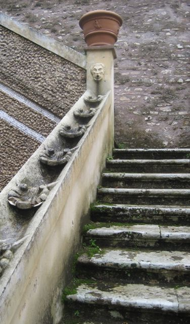 Stone steps with water running down the balustrade