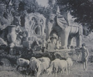 Shepards in the 1930's wander among the statues of Bomarzo.