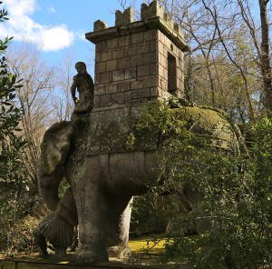 The elephant statue at Bomarzo stands in the sun.